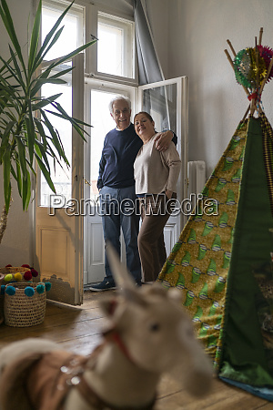 senior couple standing at the window