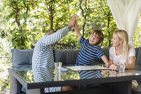 happy father and son high fiving