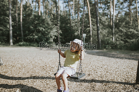 girl on swing on a playground