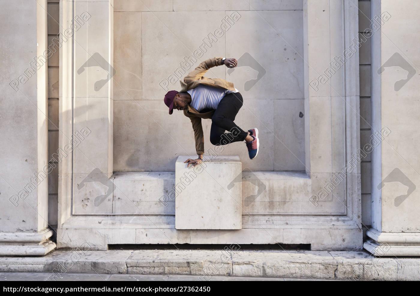 mid, adult, man, jumping - 27362450