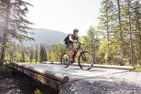 woman riding e mountain bike in