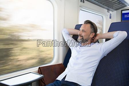 mature man sitting in a train