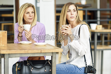 mature woman with her daughter drinking