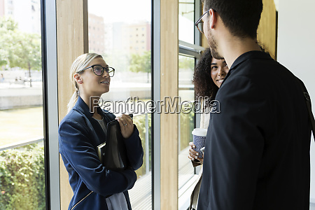 young business people talking in a