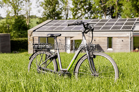 bicycle on meadow in front of