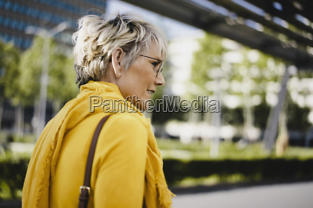 mature woman wearing glasses and yellow