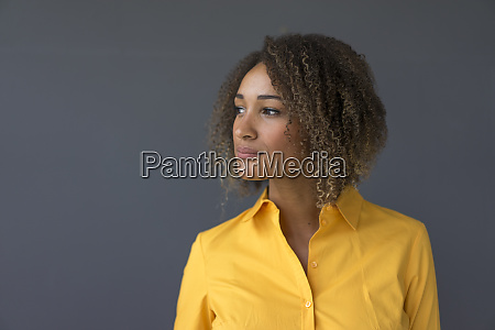 portrait of young woman wearing yellow