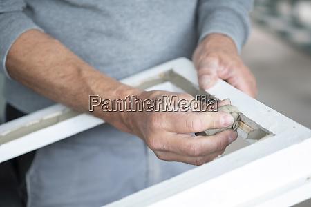 glazing glazier during work polishing window