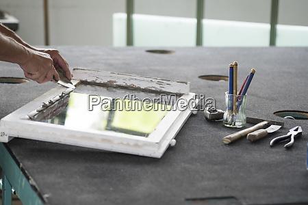 glazing glazier during work with putty