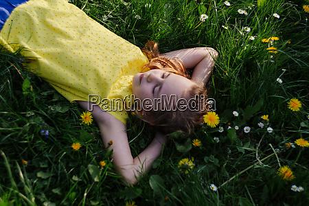 girl relaxing on flower meadow