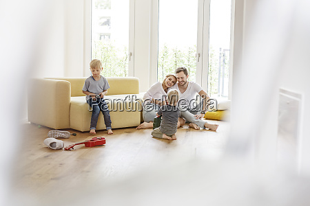 happy family with two sons playing