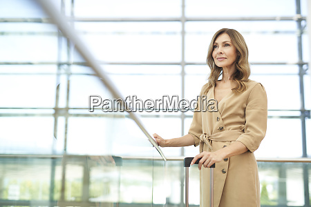 businesswoman with suitcase at airport