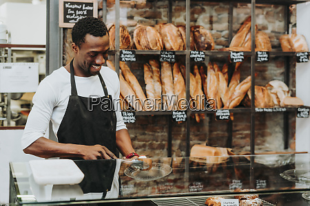 man working in a bakery