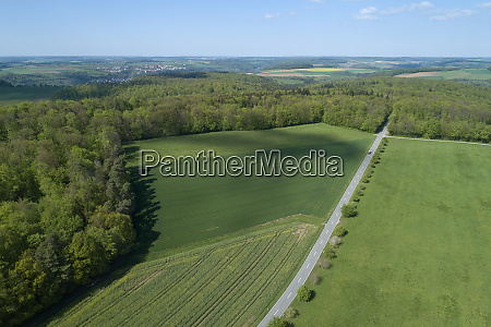 aerial view of road through agricultural