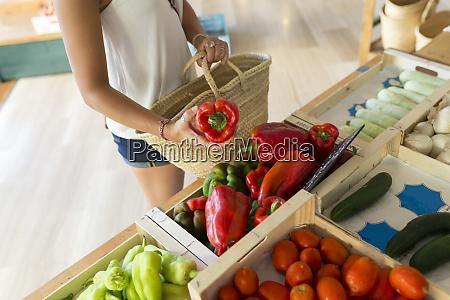 young woman in organic store choosing