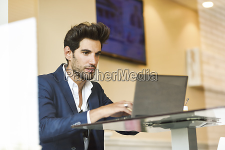 focused businessman using laptop in an