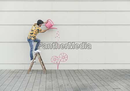 digital composite of young man watering