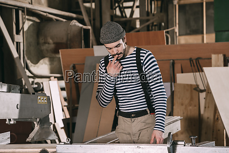 carpenter working on a saw