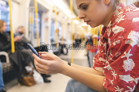 young woman travelling by train using