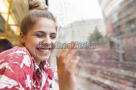 happy young woman travelling by train