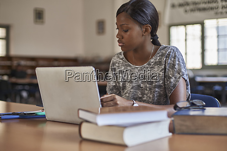 young student working with laptop at
