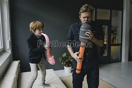 father and son playing fun instruments
