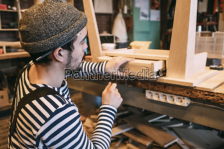 carpenter at work on wooden table
