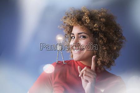 portrait of smart woman with lightbulb