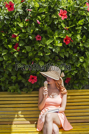 woman with book sitting on a