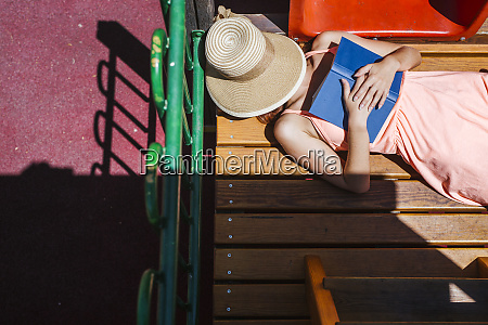 woman with book having a rest