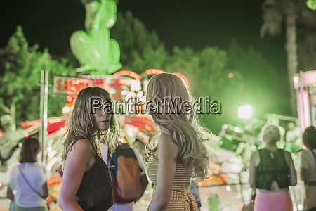 two young women on a funfair