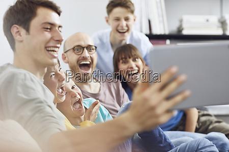 big familiy having fun at home