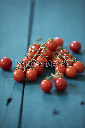 bunch tomatoes on blue wood