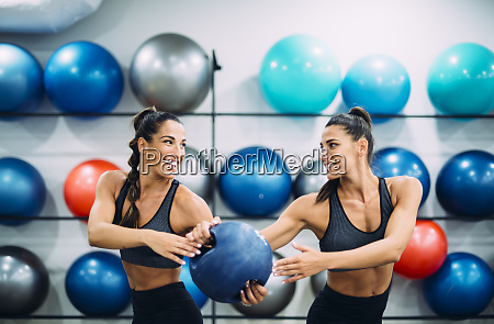 twin sisters in gym practicing with