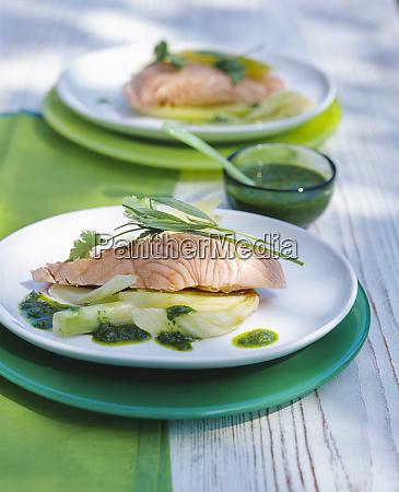poached salmon filet with pesto on