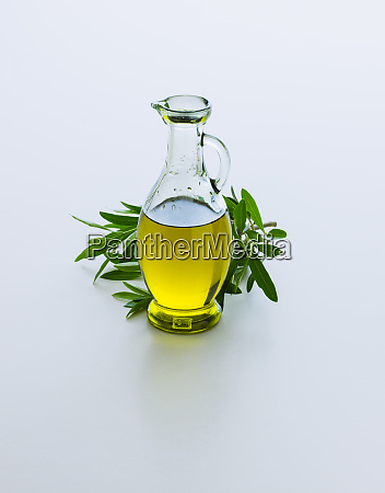 carafe with olive oil and olive