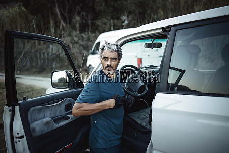 mature man standing at his off