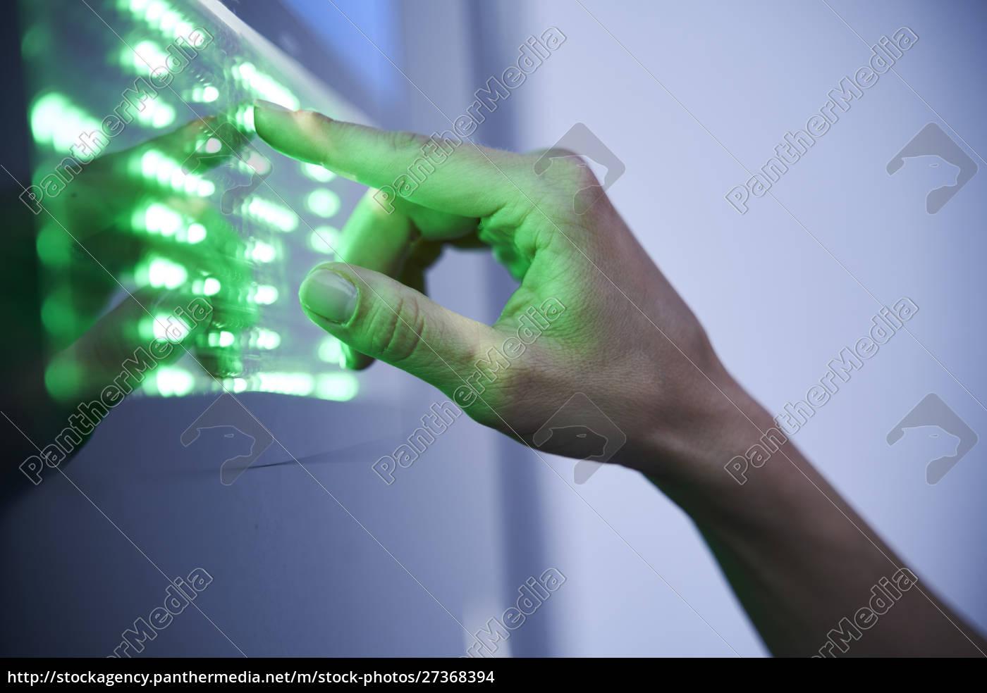 detail, of, finger, touching, green, led - 27368394