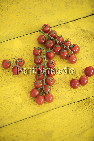 vine tomatoes on wooden table