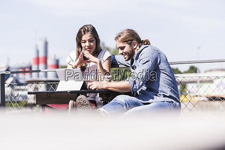 young couple using tablet in a
