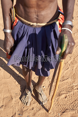 traditional mudimba tribe man holding a