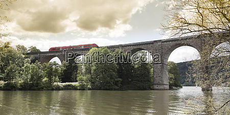 regional train crossing river ruhr on