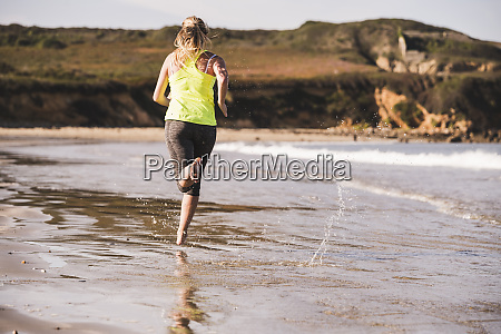 female jogger at the beach