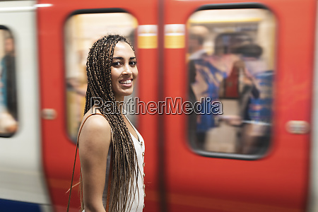 portrait of smiling young woman waiting