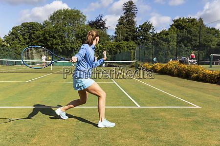mature woman during a tennis match