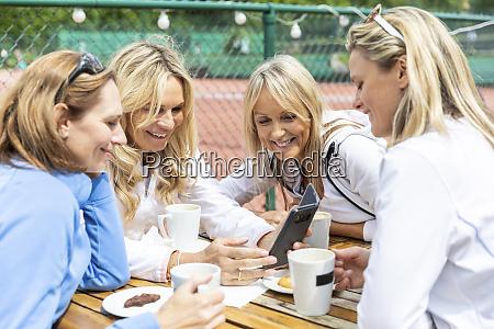 group of women enjoying tea and