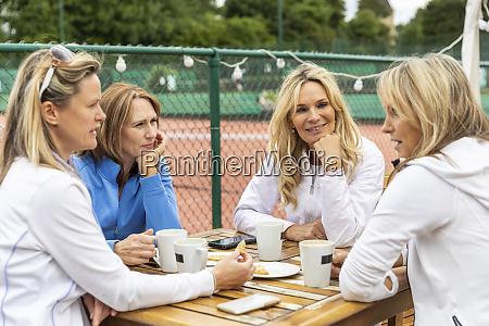 group of women talking in a