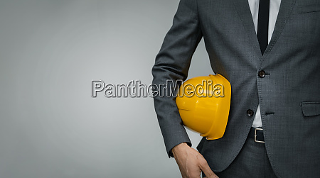 construction industry business businessman holding
