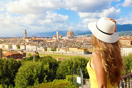 tourism in italy back view of