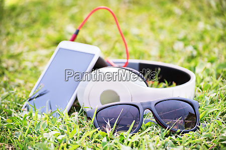 glasses with smart phone and headphones